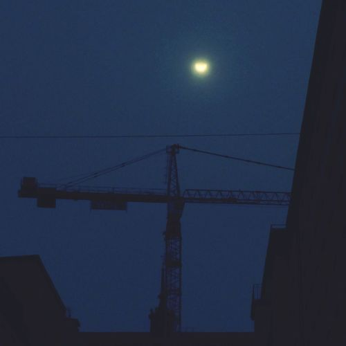 During the partial solar eclipse, March 20, 2015 The Changing City Construction Site Building Crane Solar Eclipse Silhouettes