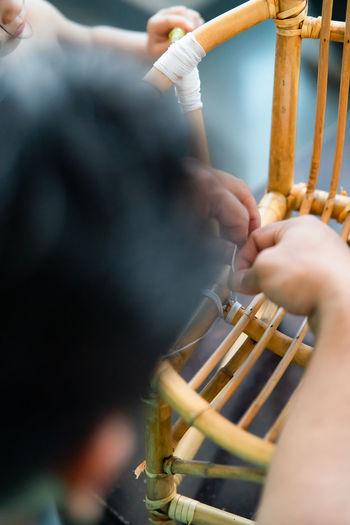 Man making bamboo chair at workshop