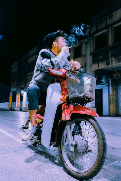 Smoker The Week On EyeEm Night One Person Full Length Christmas Real People Street Outdoors Snow Land Vehicle Winter Illuminated Sitting Cold Temperature Warm Clothing Lifestyles Christmas Decoration City People Building Exterior Adult