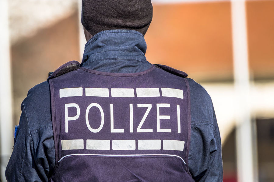 Federal police officer protecting the city in Germany Gun Murder Observation Polizei Security Stuttgart THREATS Alertness Attack Balaclava Bomb Criminal Federal Female Festival Germany Handcuffs  Mask Officers Police Protection Shooting Squad Terror Terrorism