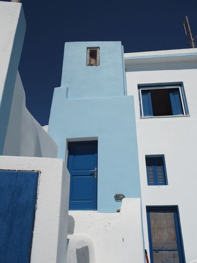 Blue on blue Greece EyeEm Selects Building Exterior Architecture Built Structure Building Window Low Angle View Sunlight Day Residential District No People Sky Blue Nature Clear Sky Outdoors