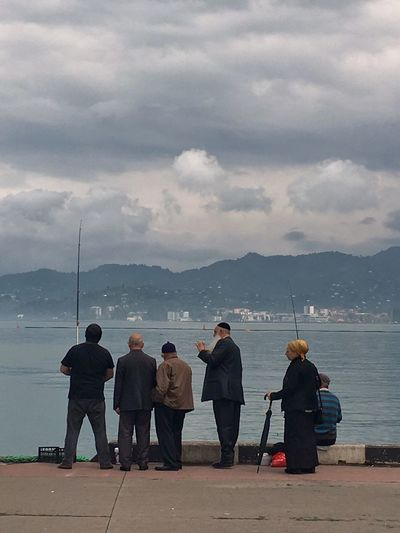 Interesting Moment Fisherman Fishing Jewish Talking Water Sky Sea Cloud - Sky Group Of People Rear View Full Length Men Real People Nature People Lifestyles Beach Standing Leisure Activity Outdoors Focus On The Story Adventures In The City