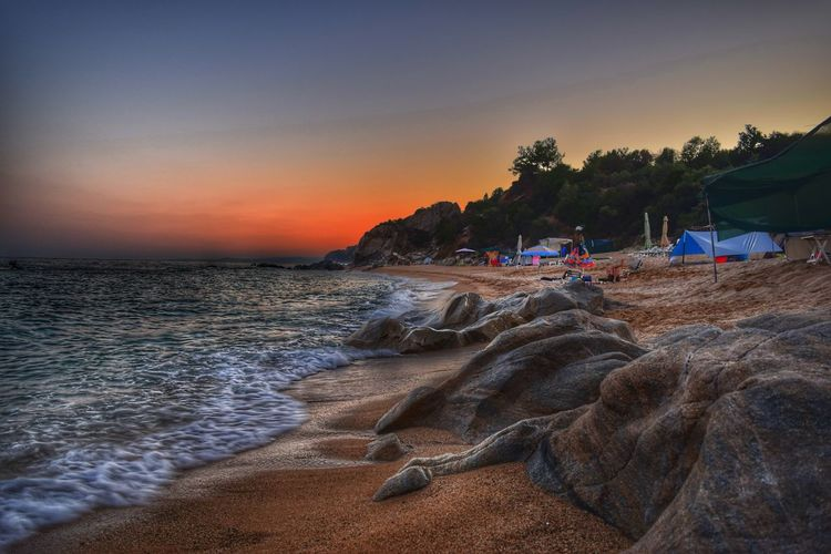 Beach Sunset Sand Sea Landscape Nature Outdoors Sky Scenics Horizon Over Water No People Vacations Wave Beauty In Nature Nature Δραμα Water Ammolofoi Rocks