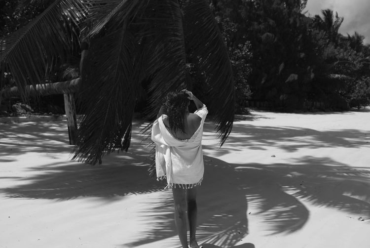 Beach Beauty In Nature Black & White Human Body Part Lifestyles One Woman Only Outdoors Palm Tree Rear View Shadow Tropical Climate Vacations White Sand Seychelles Islands Praslin TCPM The Great Outdoors - 2017 EyeEm Awards Live For The Story Sommergefühle Love Yourself Summer Exploratorium
