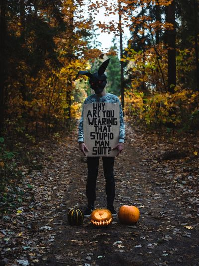 Autumn Full Length Land Day Tree Nature Pumpkin Casual Clothing One Person Forest Plant Text Halloween Standing Orange Color Food And Drink Food Communication Real People Change Halloween Holiday Celebration Donnie Darko Mask