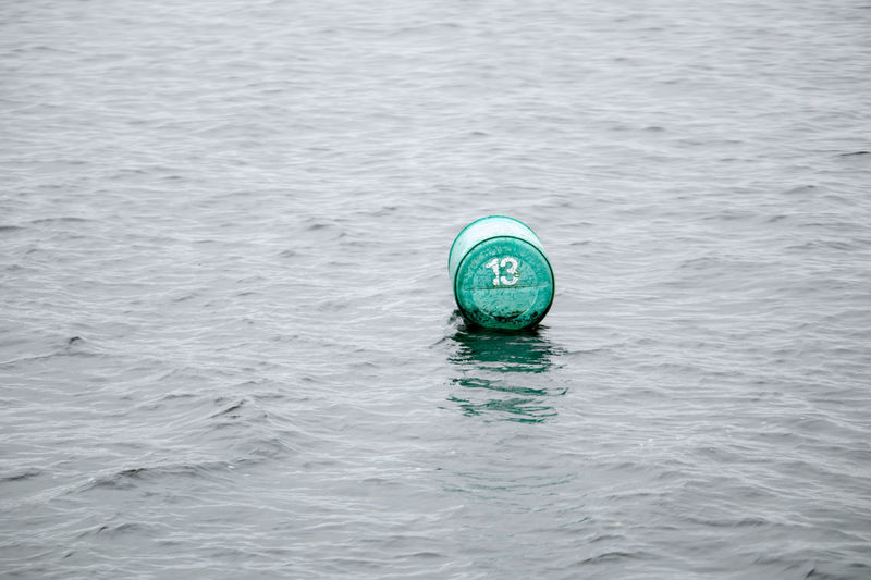 Adrift 13 Barrel Bouy Bouy In Sea Bouys Day Nature No People Outdoors Rescue Rippled Sea Unlucky Water Waterfront