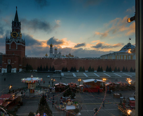 Russia, Moscow, Christmas, Red square, the Kremlin Christmas Moscow Red Square Russia Architecture Building Exterior Built Structure City Cityscape Clock Tower Cloud - Sky Day Illuminated Large Group Of People Nature Nautical Vessel Outdoors People Sky Sunset The Kremlin Travel Destinations Water