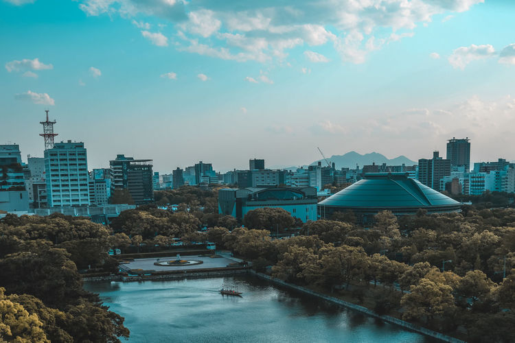// from my trip to Hiroshima 2k18 // Daytime EyeEm Japan Place Architecture Building Building Exterior Built Structure Canon City Cityscape Cloud - Sky Day Dome Historic Landscape Nature No People Office Building Exterior Outdoors Plant River Sky Skyscraper Swimming Pool Tree Urban Skyline Water The Architect - 2018 EyeEm Awards