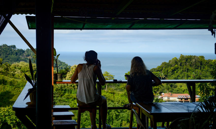 Amazing View Balcony View Costa Rica Manuel Antonio Bonding Casual Clothing Day Friendship Jungle Lifestyles Nature People Real People Rear View Sea Sitting Sky Togetherness Tree Two People Women