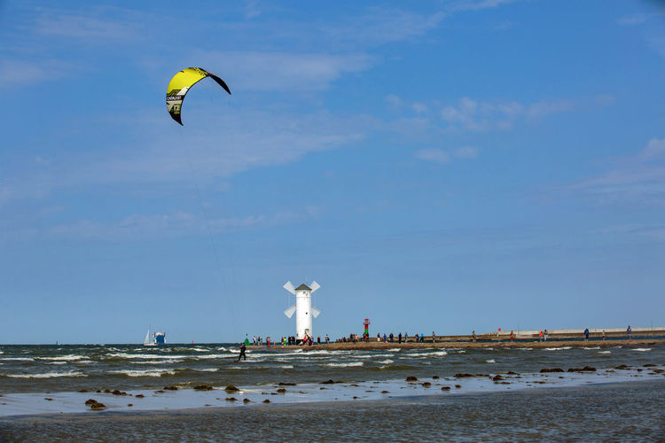 Baltic Baltic Sea Adventure Beach Day Extreme Sports Flying Freedom Horizon Over Water Kiteboarding Land Leisure Activity Mid-air Motion Nature Outdoors Parachute Paragliding Real People Scenics - Nature Sea Sky Sport Unrecognizable Person Water