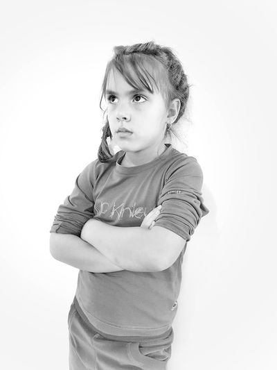 Portrait of happy girl standing against white background