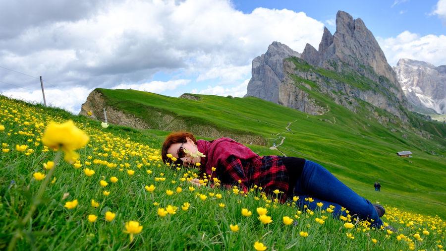 Portrait of woman lying on flowering plants