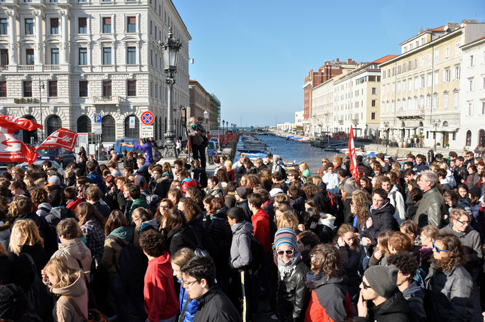 Students demonstrate in the streets of Trieste against austerity shouting slogans and waving banners City Crowd Democracy Large Group Of People Parade People Street Photography Student Protest Trieste Triesteraccontatrieste Resist