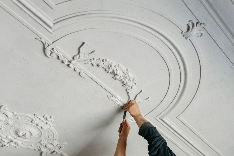 Close up man working with stucco
