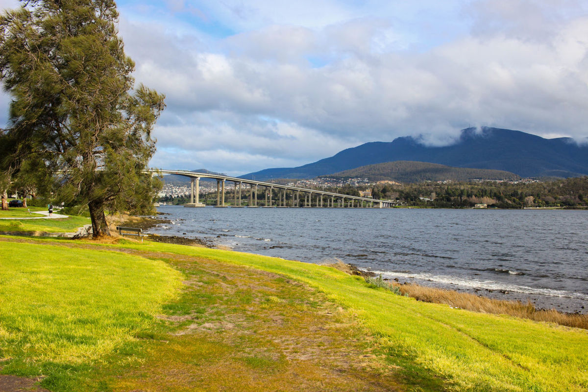 Beauty In Nature Bridge - Man Made Structure City Cloud - Sky Cloudy Connection Day Engineering Grass Green Color Growth Hobart Mountain Nature Outdoors River Riverbank Scenics Sky Tourism Tranquil Scene Tranquility Travel Destinations Tree Water
