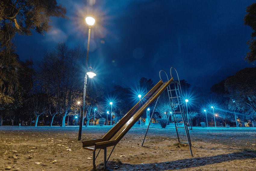 Plaza Nocturna Illuminated Night Lighting Equipment Street Light No People Nature Park - Man Made Space Tree Park Playground Street Light Beam Land Plant Absence Winter Outdoors Glowing Sky Empty Light Outdoor Play Equipment