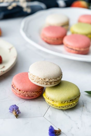 Macaroon Sweet Sweet Food Dessert Food Food And Drink Indulgence Freshness Baked Ready-to-eat Cake Unhealthy Eating Still Life Temptation No People Table Close-up Multi Colored Focus On Foreground Variation Pink Color French Food