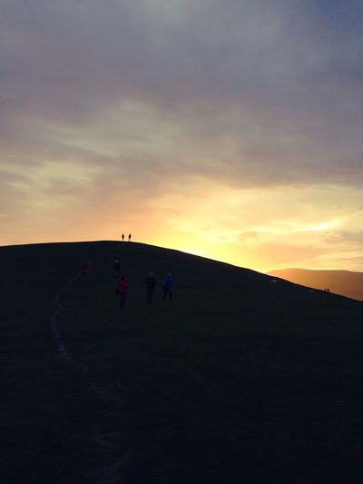 Sunset Real People Silhouette Lifestyles Sky Leisure Activity Outdoors Nature Adventure Scenics Men Beauty In Nature Landscape Mountain Day Teamwork People