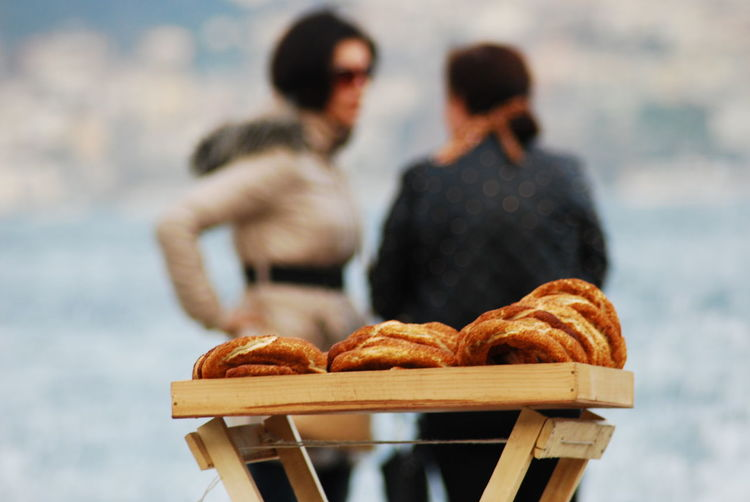 Food And Drink Food Focus On Foreground Two People Adult Baked Women Togetherness Freshness Bread Day People Real People Holding Men Basket Nature Sitting Lifestyles Three Quarter Length French Food Couple - Relationship Snack