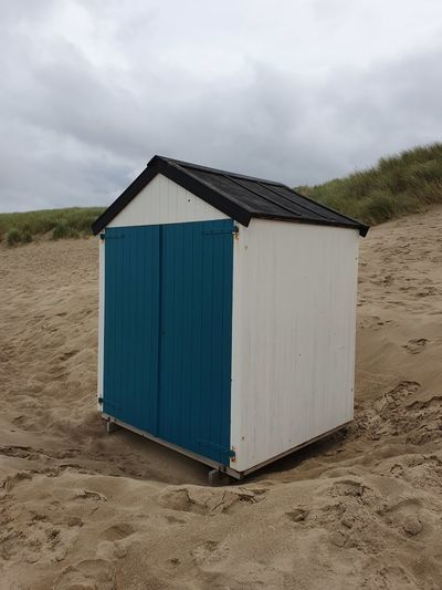 Beach hut against sky