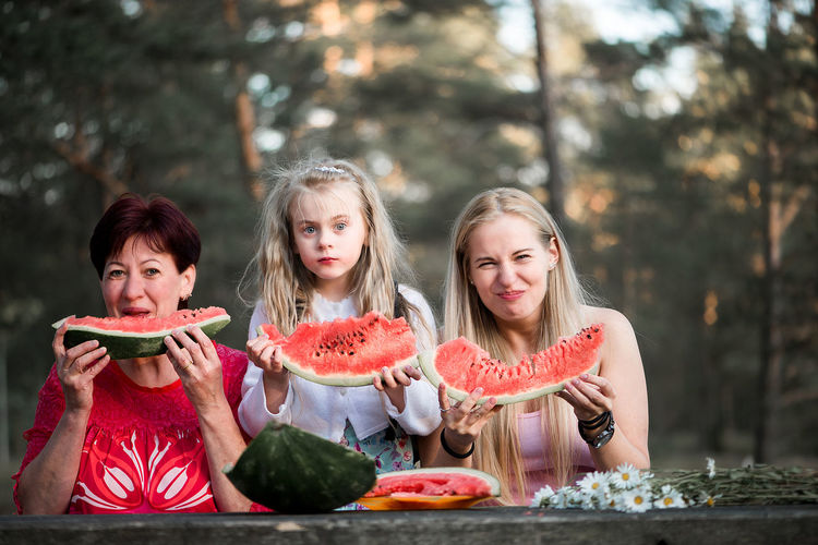 Mother and her daughters eat watermelon Child Childhood Eating Family Food Food And Drink Freshness Friendship Front View Fruit Girls Happiness Happy People Healthy Eating Healthy Lifestyle Holding Lifestyles Looking At Camera Natural Beauty Outdoors Portrait Real People Smiling Togetherness Watermelon Sommergefühle Food Stories