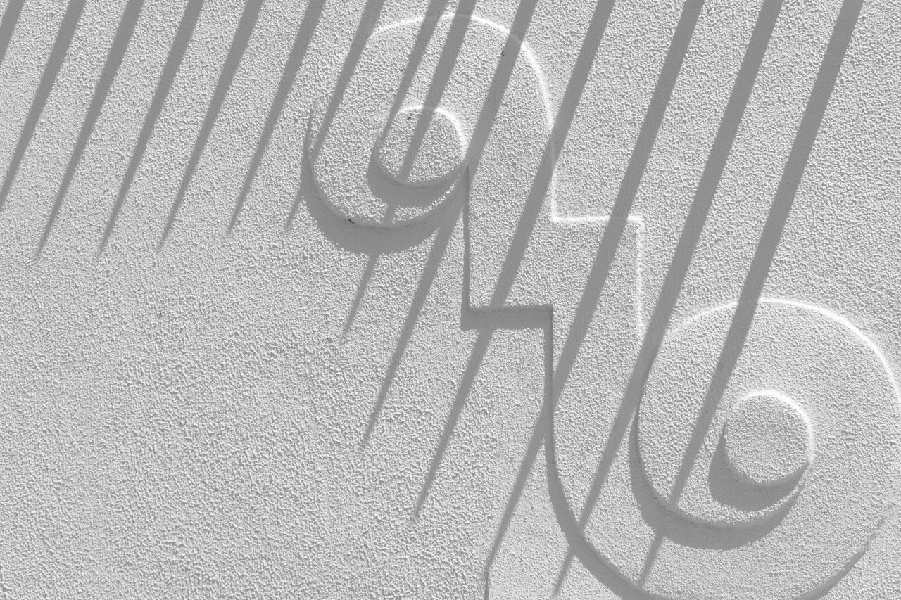 Close-Up Of Design On White Wall