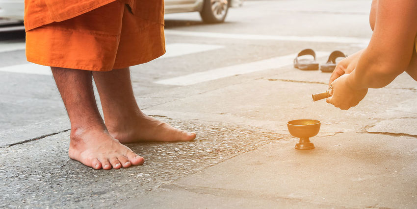 Buddhist Rice Thai barefoot Believe Blessing Buddhism Close-up Donation Food Hand Holy Human Body Part Human Hand Human Leg Leisure Activity Lifestyles Low Section Merit Monk  Outdoors People Religion Temple Togetherness