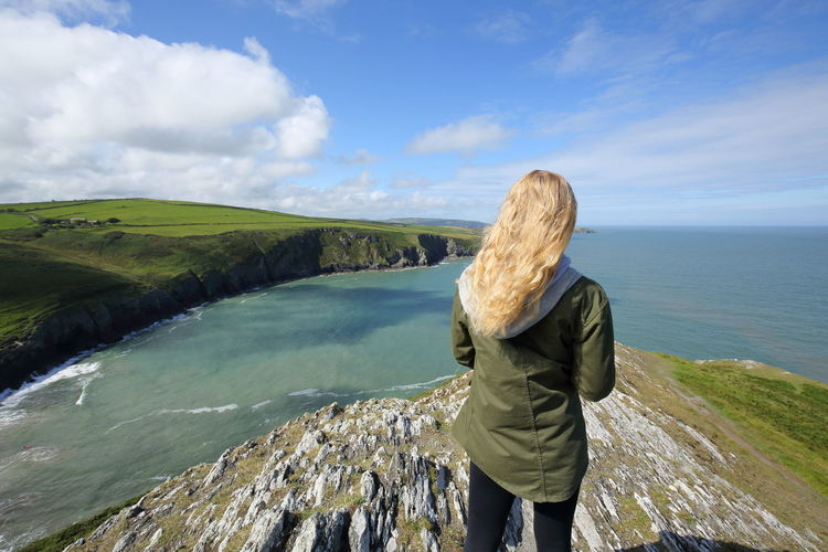 rear view of young blonde girl overlooking St. George's channel near Mwnt beach in Wales, UK Lost In The Landscape Mwnt POV Panorama Wales Beauty In Nature Casual Clothing Cloud - Sky Day Horizon Over Water Landscape Nature One Person Outdoors Panoramic Landscape Rear View Scenics Sea Sky Standing Vacations Water Women Young Women