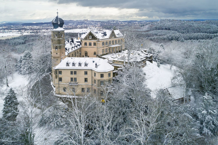 Air view of the Callenberg Palace in Coburg, Bavaria, Germany The Callenberg Palace, Town, Aerial View, Air, Air View, Architecture, Bavaria, Birds Eye Perspective, Building, Castle, Cities, Coburg, Culture, Day, Destinations, Details, Europe, European, Fort, Fortress, Germany, Historic, House, Middle Age, Travel Architecture Building Exterior Built Structure Cold Temperature Day High Angle View Nature No People Outdoors Sea Sky Snow Tree Water Winter