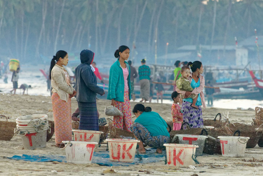 People from the village behind. Friends and family are the first to receive some of the fish caught during the night Fishing Village Rakhine State Adult Beach Childhood Day Early Morning Girls Lifestyles Marketplace Myanmar Nature Outdoors People Real People Standing Women