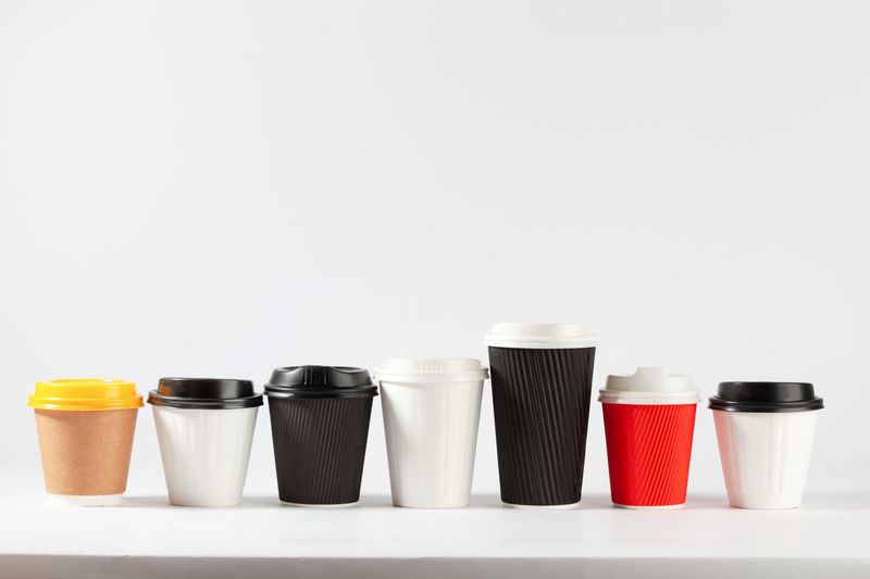 Disposable coffee cups different colors and sizes in a row on white background with copy space Coffee Time Copy Space Arrangement Choice Close-up Coffee Break Coffee Cups Coffee Cups In A Row Colorful Container Copy Space Disposable Disposable Cups Food Food And Drink Group Of Objects In A Row Indoors  Isolated On White Large Group Of Objects Lid No People Order Recyclable Items Red Side By Side Still Life Studio Shot Template Variation White Background