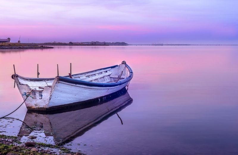 Water Sky Reflection Transportation Beauty In Nature Tranquility Scenics - Nature Nautical Vessel Sea Mode Of Transportation Moored Sunset Nature Cloud - Sky No People Outdoors Purple Tranquil Scene Beach Idyllic