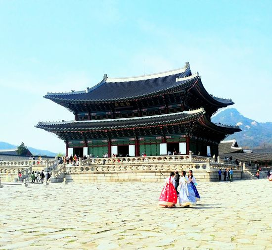 Architecture Cultures Built Structure Tourism Women Travel Destinations Day Tradition Clear Sky Place Of Worship Outdoors Men Two People Real People People Traditional Clothing Adult Sky Adults Only History Cityscape Korean Traditional Architecture Korean Culture Korean Loyalpalace Long Goodbye