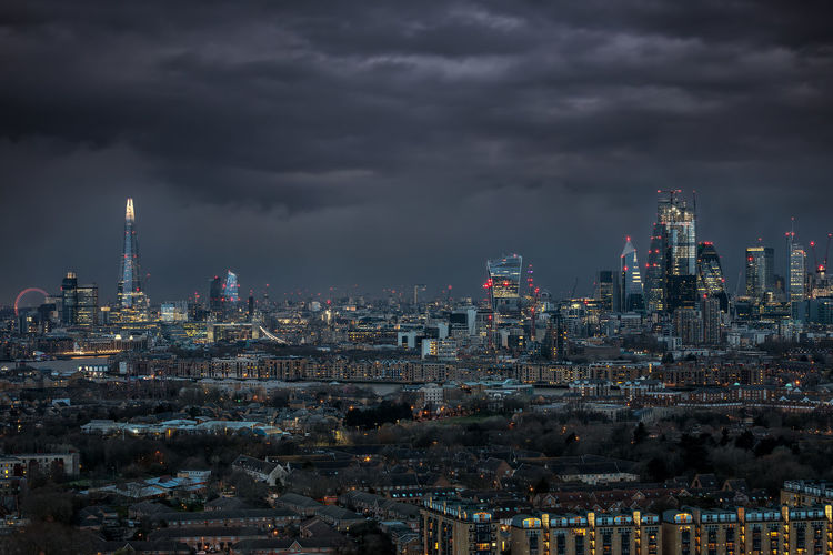 The illuminated skyline of London during night with storm clouds in the sky Cloud - Sky Sky City Cityscape Travel Destinations Urban Skyline Building Exterior Financial District  Tall - High Modern Skyscraper Building Built Structure London United Kingdom Urban Weather Storm Rain Lights Night Illuminated City Dark Office Building Exterior