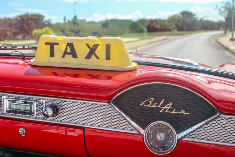 Dashboard of vintage taxi, Cuba, Varadero Mode Of Transportation Day Car Transportation Land Vehicle Outdoors Text Motor Vehicle Red No People Vintage Car Taxi Belair Radio Chrome Windshield Road Yellow Sign Cuba Varadero, Cuba Cuba. Varadero Clock