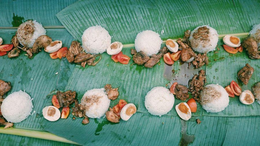 High Angle View Of Filipino Food Served On Banana Leaves