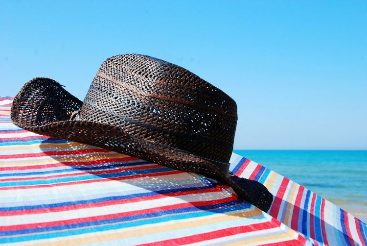 Waves Horizon Sun Lights Summer Lines Sea Adult Relaxation Blue Pattern Water Nature Multi Colored Sky Land Hat Day Beach Close-up