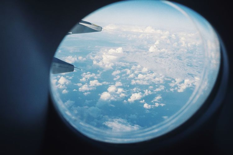 Aerial view of clouds seen through airplane window