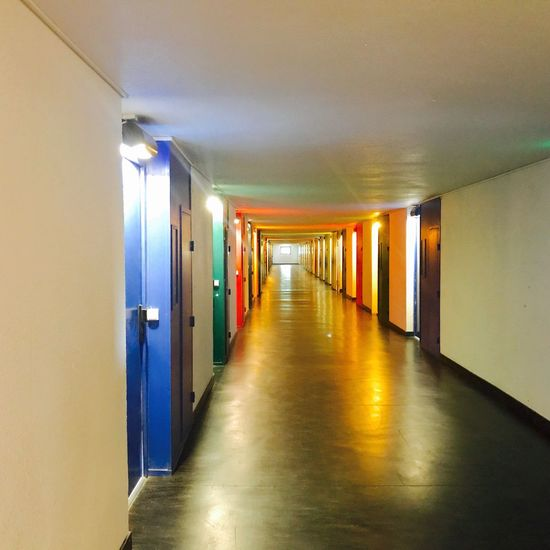 Indoors  The Way Forward Corridor Illuminated Ceiling Empty In A Row No People Built Structure Passage Architecture Day colors Colors Corbusier