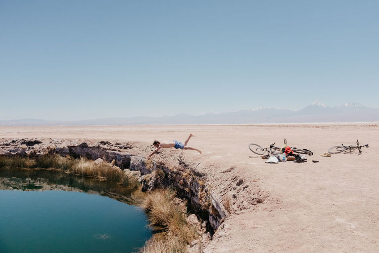 refreshing Andes Atacama Desert Biking Chile Chile♥ Exploring Man Mountain Bike Atacama Clear Sky Day Jumping Non-urban Scene One Person Outdoors Pool Scenery Sky South America Splash Water The Great Outdoors - 2018 EyeEm Awards Summer Road Tripping