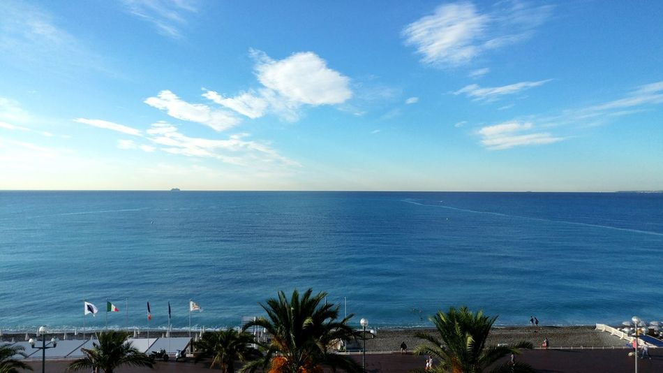 Looking out from our hotel room, the Mediterranean gets us with Cornelian blue seas. Nice, France Traveling The World Vacations Tropical Colors Historic Landscapes France Vacation Destinations Cloud - Sky Horizon Over Water Mediterranean Sea Travel Photography Copy Space No People Peaceful And Relaxing Mediterranean Seascape Travel Destinations Morning Sunlight On The Mediterranean Palm Trees Along Ocean Lost In The Landscape My Best Travel Photo