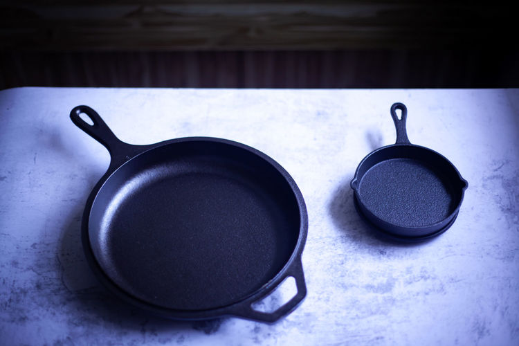 High angle view of small frying pans on table