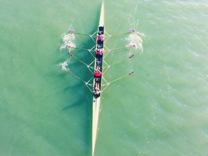 High angle view of people on rowboat in sea