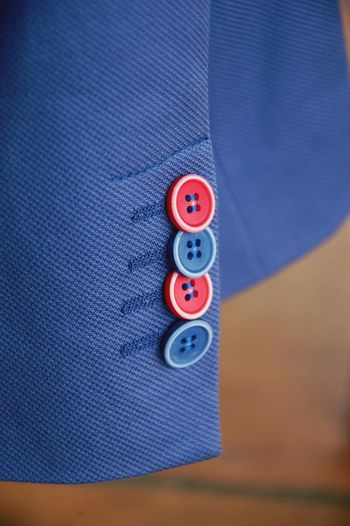 Buttons/knots At The Suit On Sleeve Blue suit Red And Blue Buttons Noble fabric Close-up No People Day Outdoors