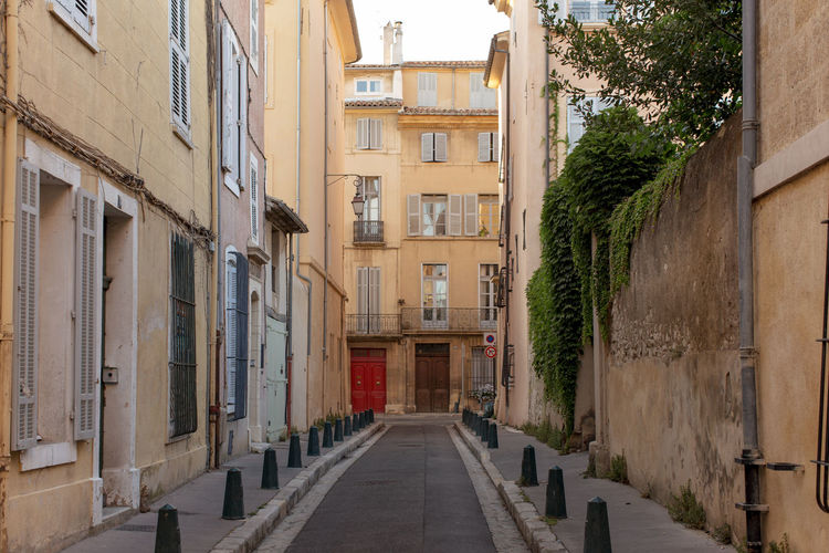 Narrow street at the Old city, Aix-en-Provence Alley Architecture Building Exterior Built Structure City City Life Day Diminishing Perspective Empty Long Narrow No People Old City Outdoors Pathway Residential Building Residential District Surface Level The Way Forward Window