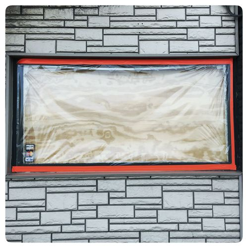 Orange Windoe frame and Textured Stone. Orange Baum Blvd Architecture