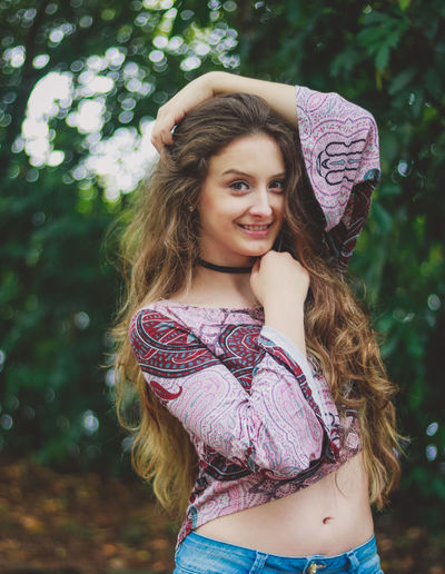 Beautiful Woman Close-up Day Fashion Focus On Foreground Front View Happiness Leisure Activity Lifestyles Long Hair Looking At Camera Nature One Person Outdoors Portrait Posing Real People Smiling Standing Tree Young Adult Young Women