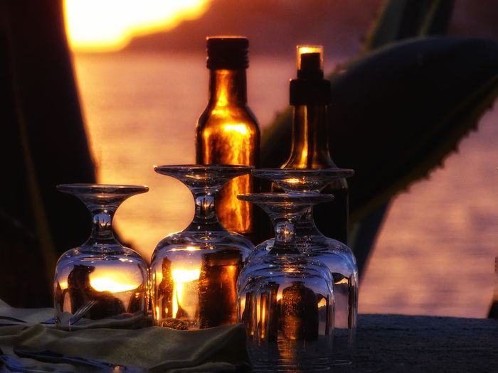 The sunset through the glasses Bosa BosaSardinia Italy S'Abba Drucche Sunset Liqueur Alcohol Drink Drinking Glass Bar - Drink Establishment Bottle Beer - Alcohol Jar