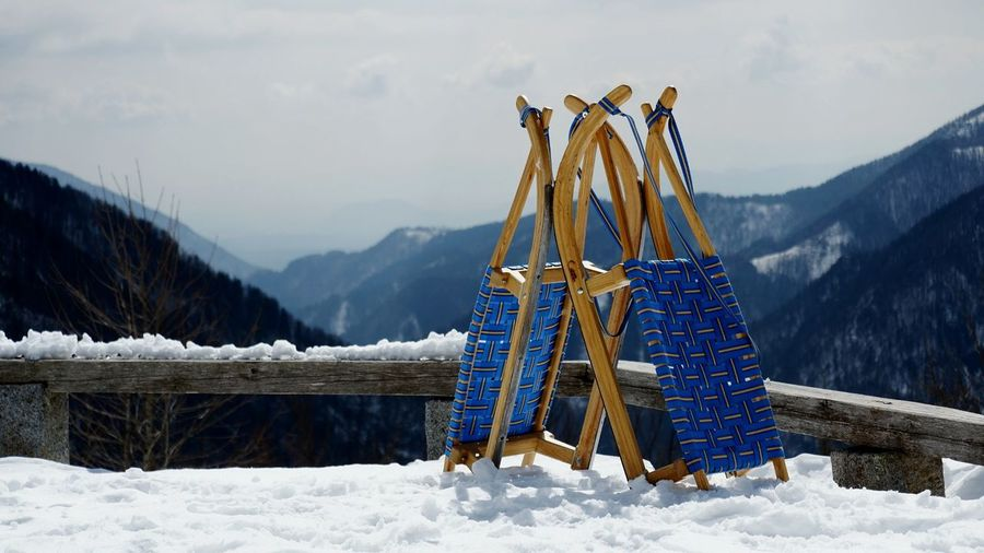 Built structure on snow covered mountains against sky
