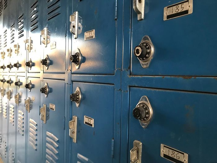 The School Lockers EyeEm Selects Closed Security Safety Entrance Door Protection Lock No People Full Frame Backgrounds Locker Metal Close-up Locker Room Pattern Dressing Room Knob Wood - Material Keyhole Privacy